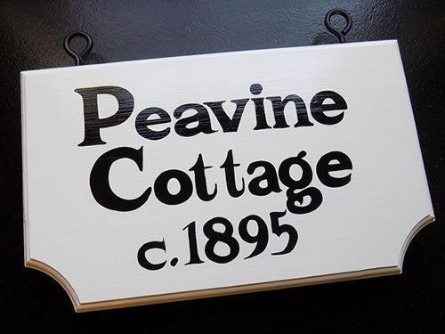 double sided hand painted cottage sign