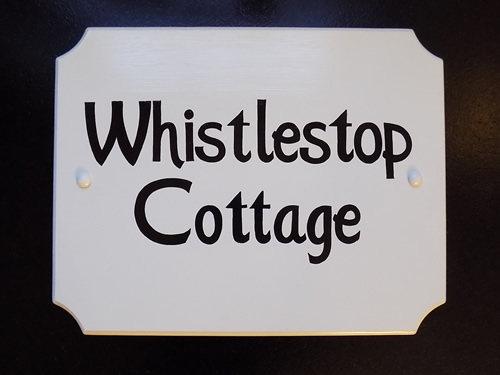 custom lettered craftsman font cottage sign