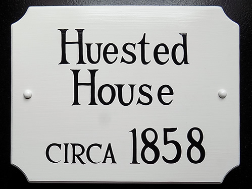 french corner historic house plaque